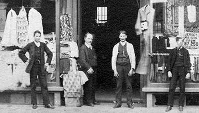 Solomon Wysanki in front of his dry goods store